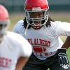 Photo - Tyre LeBlanc practices with his teammates at Carl Albert High School in Midwest City on on Tuesday, August 10, 2010. Photo by John Clanton, The Oklahoman
