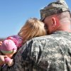 Clutching her doll, Anna Belle Carr, 20 months, leans her head against her dad\'s face as his family gathers outside the Oklahoma City Arena after the 45th Infantry Brigade Combat Team Deployment Ceremony in downtown Oklahoma City, Wednesday, Feb. 16, 2011. Capt. Donald Carr, of Blanchard, will be leaving on his sixth deployment. Photo by Jim Beckel, The Oklahoman