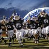 The Deer Creek team takes the field before a high school football game against Guthrie at Deer Creek in Oklahoma City, Friday, October 25, 2013. Photo by Bryan Terry, The Oklahoman