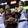 Chicago Bulls forward Carlos Boozer, center, is fouled by Dallas Mavericks forward Dirk Nowitzki (41), of Germany, under the net during the first half of an NBA basketball game, Saturday, March 30, 2013, in Dallas. Mavericks\' Shawn Marion (0) is at left. (AP Photo/ Michael Mulvey)