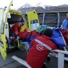 A track worker is loaded into an ambulance after he was injured when a forerunner bobsled hit him just before the start of the men\'s two-man bobsled training at the 2014 Winter Olympics, Thursday, Feb. 13, 2014, in Krasnaya Polyana, Russia. (AP Photo/Charlie Riedel)