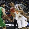 OSU\'s Le\'Bryan Nash drives through Oregon\'s Arsalan Kazemi and Johnathan Loyd in the second round of the NCAA Basketball tournament in San Jose, CA, Mar. 21, 2013. STEPHEN PINGRY/Tulsa World