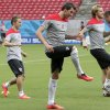 Photo - Mario Mandzukic, center, Luka Modric, left, and Ivan Rakitic, right, of Croatia warm up during a training session at the Arena Pernambuco in Recife, Brazil, Sunday, June 22, 2014. Croatia will play Mexico in group A of the 2014 soccer World Cup. (AP Photo/Petr David Josek)