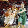 Oklahoma\'s Whitney Hand drives past North Texas\' Laura McCoy during their Dec. 6, 2012 game in Norman. Hand tore her left ACL later in the game, likely ending her collegiate career. PHOTO BY STEVE SISNEY, The Oklahoman Archives