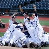 Photo - Xavier players celebrate after defeating Creighton during an NCAA college baseball game in the championship round of the Big East conference tournament, Sunday, May 25, 2014, in New York. Xavier won 5-0. (AP Photo/Jason DeCrow)