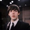 FILE - In this Feb. 1964 file photo, the Beatles\' Paul McCartney is shown on the set of the Ed Sullivan Show. McCartney turned 70 Monday June 18, 2012. McCartney turned 70 Monday June 18, 2012. (AP Photo/File)