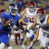Photo - Tulsa's Trey Watts (22) avoids a tackle by Iowa State's Luke Knott during the first half of an NCAA college football game, Thursday, Sept. 26, 2013 in Tulsa, Okla. (AP Photo/Tulsa World, Tom Gilbert)  ONLINE OUT; TV OUT; TULSA OUT
