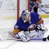 New York Islanders goalie Evgeni Nabokov keeps an eye on the puck during the first period of the NHL hockey game against the Buffalo Sabres Saturday, Feb. 9, 2013, in Uniondale, N.Y. (AP Photo/Seth Wenig)