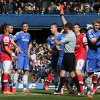 Photo - Referee Andre Marriner, in grey, sends off Arsenal's Kieran Gibbs, left, during their English Premier League soccer match between Chelsea and Arsenal at Stamford Bridge stadium in London Saturday, March 22  2014. (AP Photo/Alastair Grant)
