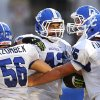 Alec James is congratulated by Deer Creek teammates after scoring the team\'s second touchdown during high school football game between the Shawnee Wolves and the Deer Creek Antlers at Harris Stadium in Shawnee, Friday night, Sep. 13, 2013. Photo by Jim Beckel, The Oklahoman.