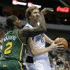Photo - Dallas Mavericks forward Dirk Nowitzki, right, drives to the basket as Utah Jazz's Marvin Williams (2) defends in the first half of an NBA basketball game, Friday, Feb. 7, 2014, in Dallas. (AP Photo/Tony Gutierrez)