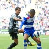 Photo -   Reading's Garath McCleary, right, shields the ball from Tottenham Hotspur's Kyle Naughton during their English Premier League soccer match at the Madjeski stadium, Reading, England, Sunday, Sept. 16, 2012. (AP Photo/Tom Hevezi)