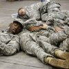 Five soldiers nap on the floor. A US Army spokesman from Ft. Sill said nearly 1,000 troops boarded buses for the trip to Will Rogers World Airport in Oklahoma City to catch flights home for the Christmas holidays. Buses filled with soldiers began arriving at the airport after midnight Wednesday and into the pre-dawn hours on Thursday, Dec. 19, 2013. While waiting to board flights, the troops were treated to food and warm beverages at the YMCA Military Welcome Center at the airport. Soldiers were offered pizza, doughnuts and sub sandwiches, with hot coffee or chocolate, and bottled water. Friendly faces from local organizations were there to greet them and assist them. Volunteers represented several groups, including Blue Star Mothers, Patriot Guard Riders and an organization consisting of Purple Heart recipients. Photo by Jim Beckel, The Oklahoman