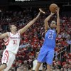Oklahoma City Thunder\'s Kevin Martin (23) shoots over Houston Rockets\' Francisco Garcia (32) in the second quarter of Game 6 in a first-round NBA basketball playoff series Friday, May 3, 2013, in Houston. (AP Photo/Pat Sullivan)