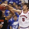 Kansas center Jeff Withey (5) fouls Oklahoma State guard/forward Le\'Bryan Nash (2) during the first half of an NCAA college basketball game in Lawrence, Kan., Saturday, Feb. 11, 2012. (AP Photo/Orlin Wagner) ORG XMIT: KSOW101