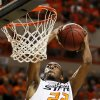Photo - ALTERNATE CROP: Oklahoma State's Markel Brown (22) dunks the ball during a men's college basketball game between Oklahoma State University (OSU) and the University of Texas at Gallagher-Iba Arena in Stillwater, Okla., Saturday, March 2, 2013. Photo by Nate Billings, The Oklahoman