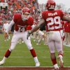 Oklahoma\'s Sam Bradford (14) and Chris Brown (29) celebrate after Brown\'s touchdown during the first half of the college football game between the University of Oklahoma Sooners (OU) and the Oklahoma State University Cowboys (OSU) at the Gaylord Family-Memorial Stadium on Saturday, Nov. 24, 2007, in Norman, Okla. Photo By CHRIS LANDSBERGER, The Oklahoman