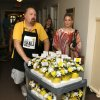 Photo -  Steve Snow, with Howard Brothers Florists, and Jennifer Ochley, activities director at Village on the Park Senior Living Center, pass out flowers on Tuesday. Photo by Paul Hellstern, The Oklahoman   PAUL HELLSTERN -