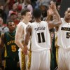 Missouri\'s Leo Lyons (5) and Zaire Taqylor (11) celebrate the win over Baylor in the Championship game of the Big 12 Men\'s Basketball Championships between Baylor University and The University of Missouri at the Ford Center on Saturday, March 14, 2009, in Oklahoma City, Okla. PHOTO BY CHRIS LANDSBERGER, THE OKLAHOMAN