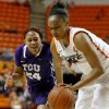 Oklahoma State\'s Kendra Suttles (31) gains control of the ball beside TCU\'s Natalie Ventress (24) during a women\'s college basketball game between Oklahoma State University and TCU at Gallagher-Iba Arena in Stillwater, Okla., Tuesday, Feb. 5, 2013. Oklahoma State won 76-59. Photo by Bryan Terry, The Oklahoman