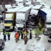 Photo - UPDATES NUMBER OF VEHICLES INVOLVED - In this photo provided by the Indiana State Police, emergency crews work at the scene of a massive pileup involving more than 40 vehicles, many of them semitrailers, along Interstate 94 Thursday afternoon, Jan. 23, 2014 near Michigan City, Ind. At least three were killed and more than 20 people were injured. (AP Photo/Indiana State Police)