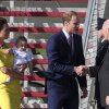 Britain\'s Prince William, center, his wife Kate, the Duchess of Cambridge and their son Prince George are greeted by Australian Governor General Peter Cosgrove as they arrive in Sydney, Australia Wednesday, April 16, 2014. The royal family kicked off their tour of Australia. (AP Photo/Rob Griffith)