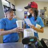 Photo - Dairy Boy Drive In owner Karen Bratcher, left, and her daughter, Bobbie Sue Tallent finish an order at the family owned drive in located on SW 3rd St in Minco  Thursday  August  14, 2014. Photo By Steve Gooch, The Oklahoman