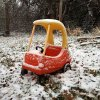 Photo - A toy car in a backyard in Edmond collects snow Friday morning December 28, 2012. Photo by Doug Hoke, The Oklahoman