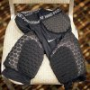 Photo -   A sample of the new thigh pads the NFL made mandatory equipment for the 2013 football season sit on a chair following a news conference at an owners meeting, Tuesday, May 22, 2012, in Atlanta. (AP Photo/David Goldman)