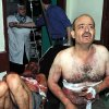 In this photo released by the Syrian official news agency SANA, two injured Syrian men who were wounded after two bombs exploded at Qazaz neighborhood, react at a hospital in Damascus, Syria, on Thursday May 10, 2012. Two strong explosions ripped through the Syrian capital Thursday, killing or wounding dozens of people and leaving scenes of carnage in the streets in an assault against a center of government power. (AP Photo/SANA) ORG XMIT: BEI110