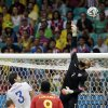 Photo - United States' goalkeeper Tim Howard (1) saves a shot during the World Cup round of 16 soccer match between Belgium and the USA at the Arena Fonte Nova in Salvador, Brazil, Tuesday, July 1, 2014. (AP Photo/Felipe Dana)