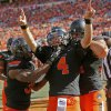 Oklahoma State\'s J.W. Walsh (4) celebrates a touchdown run in the second quarter with Jeremy Smith (31), left, and Jeremy Seaton (44) during a college football game between the Oklahoma State University Cowboys (OSU) and the Kansas State University Wildcats (KSU) at Boone Pickens Stadium in Stillwater, Okla., Saturday, Oct. 5, 2013. Photo by Nate Billings, The Oklahoman