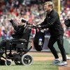 Marathoners Dick Hoyt, right, and his son Rick come onto the field for the ceremonial first pitch before a baseball game between the Boston Red Sox and the Kansas City Royals in Boston, Saturday, April 20, 2013. Playing at home for the first time since two explosions at the Boston Marathon finish line killed three people and wounded more than 180 others, the Red Sox honored the victims and the survivors with a pregame ceremony and an emotional video of scenes from Monday\'s race. (AP Photo/Michael Dwyer) ORG XMIT: MAMD145