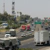 FILE - In this Aug. 23, 2011 file photo, a stretch of the Calif. State Route 99 corridor in the San Joaquin Valley is shown busy with traffic in Fresno, Calif. CThe United Nations climate chief is urging people not to look solely to their governments to make tough decisions to slow global warming, and instead to consider their own role in solving the problem. Approaching the half-way point of two-week climate talks in Doha, Christiana Figueres, the head of the U.N.\'s climate change secretariat, said Friday, Nov. 30, 2012 that she didn\'t see
