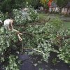 Glenn Hoffman tries to clear Symmes Street of trees that fell across the road as a result of a severe storm on Tuesday, June 14, 2011, in Norman, Okla. Photo by Steve Sisney, The Oklahoman