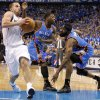 JOSE BAREA: Jose Juan Barea (11) of Dallas goes past Oklahoma City\'s Nate Robinson (3) and James Harden (13) during game 1 of the Western Conference Finals in the NBA basketball playoffs between the Dallas Mavericks and the Oklahoma City Thunder at American Airlines Center in Dallas, Tuesday, May 17, 2011. Photo by Bryan Terry, The Oklahoman BRYAN TERRY