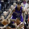 Photo - Portland Trail Blazers guard Damian Lillard, bottom, passes off as Sacramento Kings forward James Johnson defends during the first quarter of an NBA basketball game in Portland, Ore., Wednesday, Dec. 26, 2012. (AP Photo/Don Ryan)