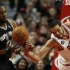 Chicago Bulls center Joakim Noah, right, loses the ball to San Antonio Spurs small forward Kawhi Leonard (2) during the first half of an NBA basketball game on Tuesday, March 11, 2014, in Chicago. (AP Photo/Andrew A. Nelles)
