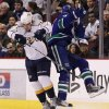 Nashville Predators\' Shane O\'Brien, left, and Vancouver Canucks\' Ryan Kesler collide during the first period of an NHL hockey game in Vancouver, British Columbia, on Wednesday, Jan. 26, 2011. (AP Photo/The Canadian Press, Darryl Dyck)