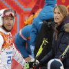 Photo - United States' Bode Miller talks with his wife Morgan near the finish area after completing Men's super combined downhill training at the Sochi 2014 Winter Olympics, Tuesday, Feb. 11, 2014, in Krasnaya Polyana, Russia. (AP Photo/Christophe Ena)