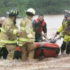 Firefighters rescue motorists from a bridge near Hefner Road and Sooner Road. Photos by Steve Gooch, The Oklahoman