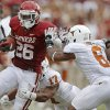 OU\'s Damien Williams (26) fights off UT\'s Adrian Phillips (17) and Quandre Diggs (6) during the Red River Rivalry college football game between the University of Oklahoma (OU) and the University of Texas (UT) at the Cotton Bowl in Dallas, Saturday, Oct. 13, 2012. Oklahoma won 63-21. Photo by Bryan Terry, The Oklahoman