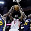 Houston Rockets\' James Harden (13) goes to the basket while double-teamed by Utah Jazz Al Jefferson (25) and Paul Millsap (24) in the first half of an NBA basketball game on Saturday, Dec. 1, 2012, in Houston. (AP Photo/Pat Sullivan)