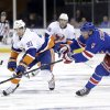 New York Rangers\' Anton Stralman, right, tries to block a pass by New York Islanders\' John Tavares during the first period of the NHL hockey game in New York, Thursday, Feb. 7, 2013. (AP Photo/Seth Wenig)