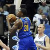 Photo -   Minnesota Timberwolves' Greg Stiemsma, right, looks on as Golden State Warriors' Festus Ezeli, of Nigeria, pulls in a rebound in the first half of an NBA basketball game on Friday, Nov. 16, 2012, in Minneapolis. (AP Photo/Jim Mone)