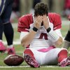 Photo -   Arizona Cardinals quarterback Kevin Kolb reacts after being sacked during the third quarter of an NFL football game against the St. Louis Rams, Thursday, Oct. 4, 2012, in St. Louis. The Rams won 17-3. (AP Photo/Tom Gannam)