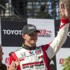 Graham Rahal (15) waves to fans after his second place finish in the IndyCar Series Grand Prix of Long Beach auto race, Sunday, April 21, 2013, in Long Beach, Calif. (AP Photo/Ringo H.W. Chiu)