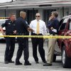 Michael Haworth, second from right, gathers information from his officers and a detective at the scene of Kenvin\'s Motel, where Anthony Giancola used a microwave to attack the married couple who own the motel, Friday, June 22, 2012, in Lealman, Fla. Authorities said Giancola, an ex-Tampa Bay-area middle school principal who lost his job over a drug arrest five years ago, went on a rampage Friday, stabbing several people, killing at least two. Authorities said there were 11 victims in all, and several are being treated at area hospitals for injuries ranging from minor to life-threatening. (AP Photo/Tampa Bay Times, Melissa Lyttle) TAMPA OUT; CITRUS COUNTY OUT; PORT CHARLOTTE OUT; BROOKSVILLE HERNANDO TODAY OUT