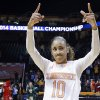Photo - Tennessee guard Meighan Simmons acknowledges the crowd as she leaves the court following a win over St. John's in an NCAA women's college basketball second-round tournament game Monday, March 24, 2014, in Knoxville, Tenn. Simmons scored 17 points as Tennessee won 67-51. (AP Photo/Mark Humphrey)