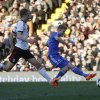Photo - Chelsea's Andre Schurrle, right, kicks the ball to score his second goal against Fulham during their English Premier League soccer match at Craven Cottage, London, Saturday, March 1, 2014. (AP Photo/Sang Tan)